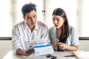 Man and woman try to find money to pay credit card debt and all loan bills. Financial problem from coronavirus or covid-19