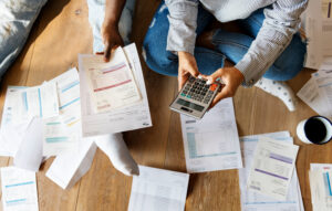 Couple managing the debt - Prudent Financial Solutions