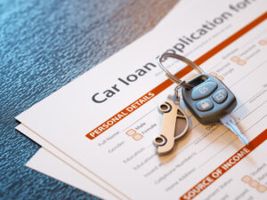 Car loan application with car keys - Prudent Financial Solutions