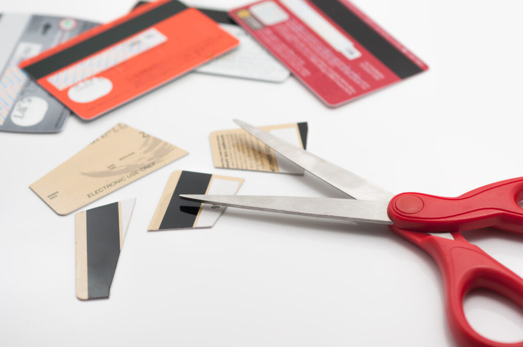 Cuting credit cards with scissors - Prudent Financial Solutions
