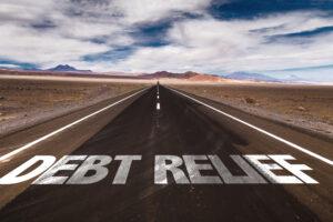 Debt Relief written on desert road - Prudent Financial Solutions