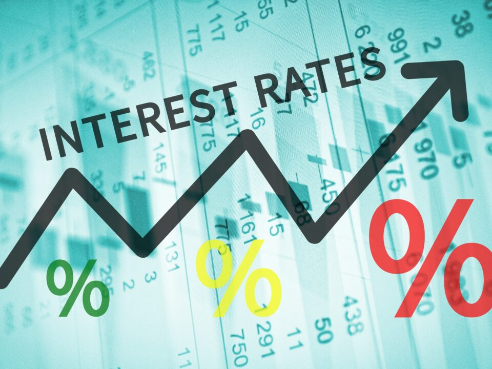 Text Interest rates on up trend arrow, with financial data visible - Prudent Financial Solutions