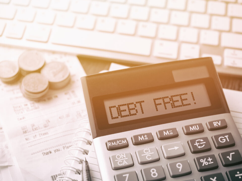 Calculator with text Debt Free! - Prudent Financial Solutions