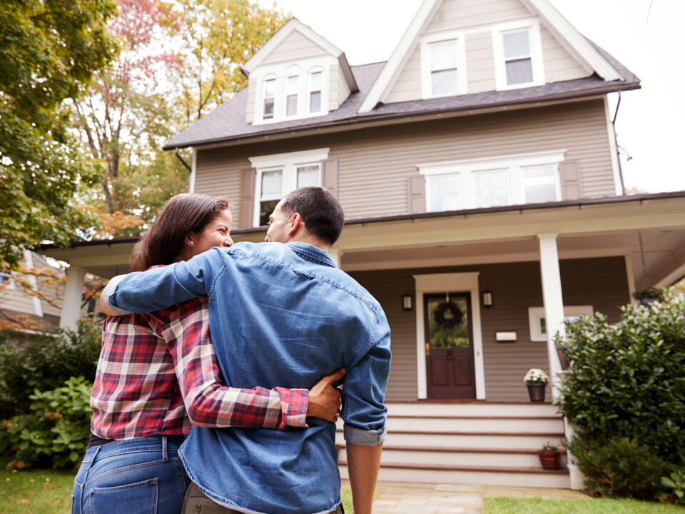 Rear View Of Loving Couple Walking Towards House - Prudent Financial Solutions