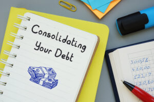consolidating your debt written on a notebook