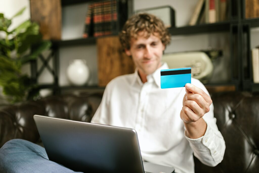 man holding his credit card